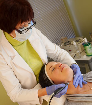 Carol doing microdermabrasion