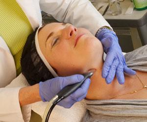 Carol performing microdermabrasion procedure