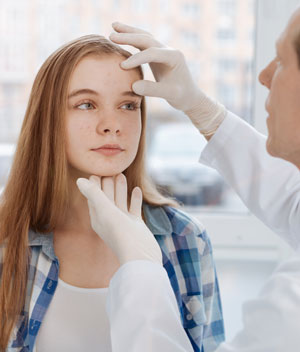young girl patient with dermatologist